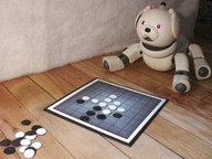 Robot Aibo jouant au jeu Othello